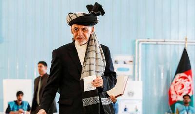 """阿富汗大选喜忧参半中完成首轮投票,塔利班未构成威胁,""""双巨头""""将进入第二轮"""